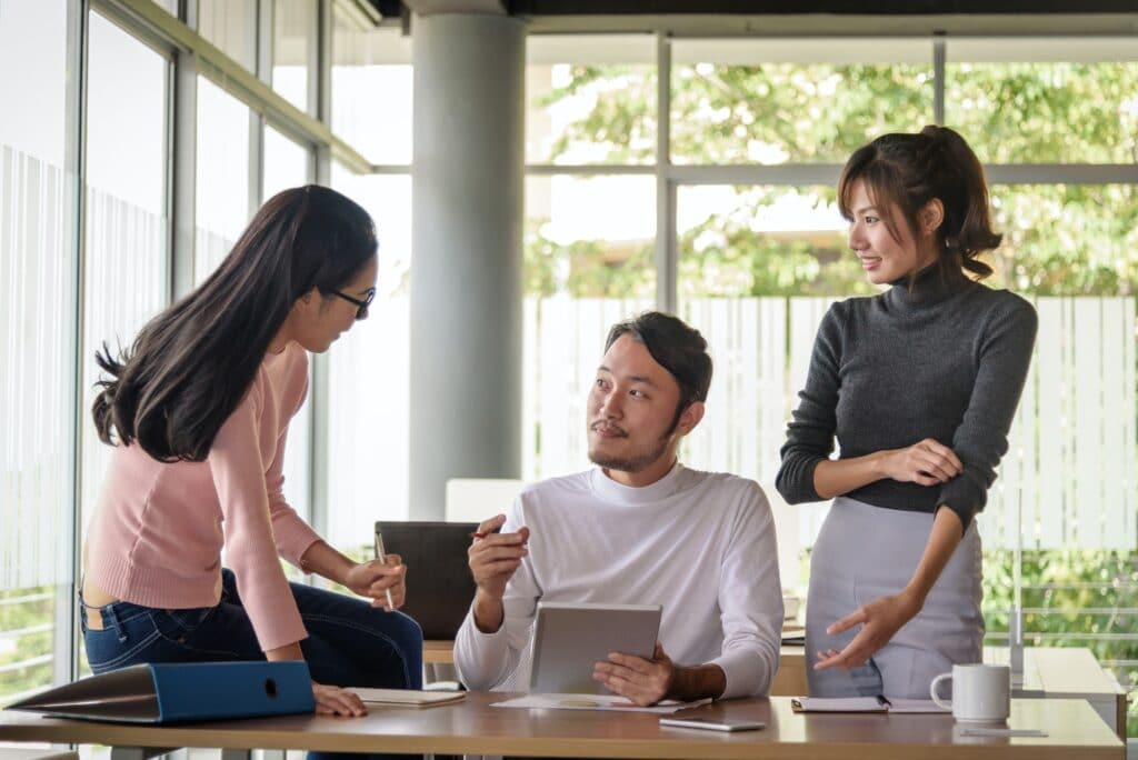 young asian businessman working with team in startup office